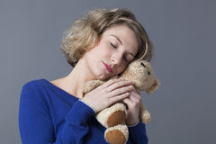 Female tenderness for happiness and cozyness from child memories Stock Photo