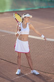 Female Tennis Athlete Equipped with Professional Outfit Standing Royalty Free Stock Images