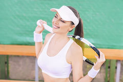 Female Tennis Athlete Equipped with Professional tennis Outfit o Stock Photo