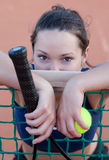 Female tennis behind the net Stock Image