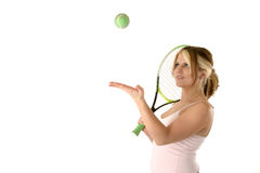 Female Tennis Player. Tossing a ball in the air while holding her raquet stock photography