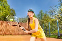 Female tennis player in action outdoor Royalty Free Stock Photo