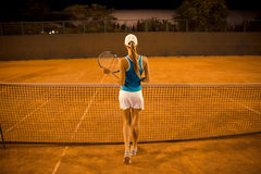 Female tennis player. Back view portrait of a female tennis player royalty free stock photography