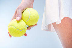 Female tennis player with balls Stock Images