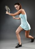 Female tennis player executing a forehand Royalty Free Stock Photo