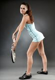 Female tennis player executing a serve Royalty Free Stock Photography