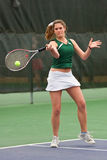 Female Tennis Player Hits Forehand Shot Royalty Free Stock Photography