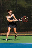 Female Tennis Player Hits Powerful Backhand Royalty Free Stock Image