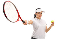 Female tennis player holding a ball and a racket Stock Photo