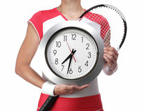 Female tennis player holding a clock Stock Photo