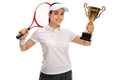Female tennis player holding a gold trophy Royalty Free Stock Image