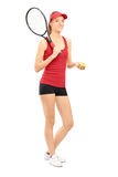 Female tennis player holding a racket and ball Royalty Free Stock Image