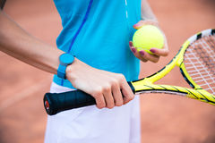 Female tennis player holding racket and ball Royalty Free Stock Photography
