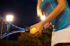 Female tennis player holding racket and ball Stock Images