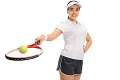 Female tennis player holding racket with ball Royalty Free Stock Photo