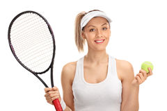 Female tennis player holding a racket and a ball Royalty Free Stock Image