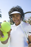 Female Tennis Player Holding Racquet And Balls Stock Images