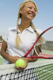Female Tennis Player at net on tennis court Stock Images