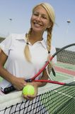 Female Tennis Player at net on tennis court portrait Royalty Free Stock Images