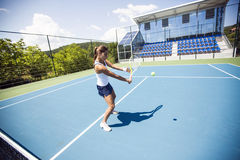 Female tennis player performing a drop shot Royalty Free Stock Photo