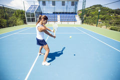 Female tennis player performing a drop shot Stock Images