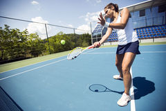 Female tennis player performing a drop shot Royalty Free Stock Photos
