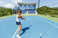 Female tennis player performing a drop shot Stock Photography