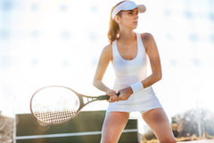 Female tennis player playing match on court Royalty Free Stock Photography