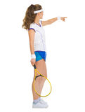 Female tennis player pointing on copy space Royalty Free Stock Image
