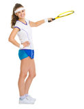 Female tennis player pointing on copy space Stock Photos