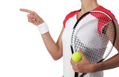 Female tennis player pointing at something Royalty Free Stock Images