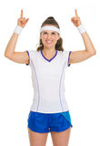 Female tennis player pointing up on copy space Stock Images