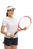 Female tennis player posing with ball and racket Royalty Free Stock Photos