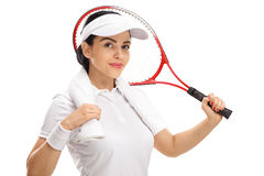Female tennis player posing with racket and towel Stock Photos