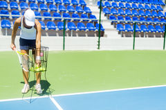 Female tennis player practicing service royalty free stock image