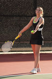 Female Tennis Player Prepares To Serve In Match Stock Image