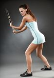 Female tennis player preparing to hit Stock Images