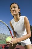Female Tennis Player Preparing to Serve close up Royalty Free Stock Images