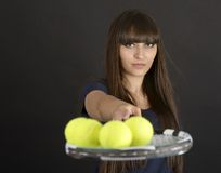 Female tennis player with racket and ball on black background Royalty Free Stock Photo