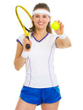 Female tennis player with racket and ball Stock Images
