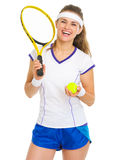 Female tennis player with racket and ball Royalty Free Stock Photography