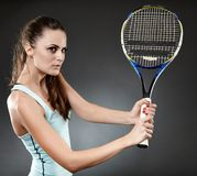 Female tennis player with racket executing volley Royalty Free Stock Photography