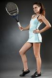 Female tennis player with racket Royalty Free Stock Photos