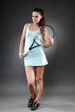Female tennis player with racket Stock Photography