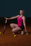 Female Tennis Player With A Racket Indoors Stock Images