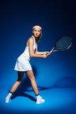 Female tennis player with racket ready to hit a ball. Royalty Free Stock Photo