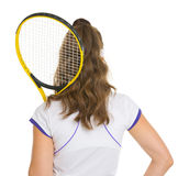 Female tennis player with racket . rear view Royalty Free Stock Photography