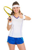 Female tennis player with racket showing thumbs up Royalty Free Stock Photo