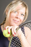 Female tennis player racquet ball healthy. Happy smiling female tennis player with racquet and ball healthy lifestyle concept Royalty Free Stock Photography