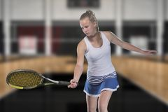 Female tennis player reaching to hit the tennis ball on court.  Royalty Free Stock Photos